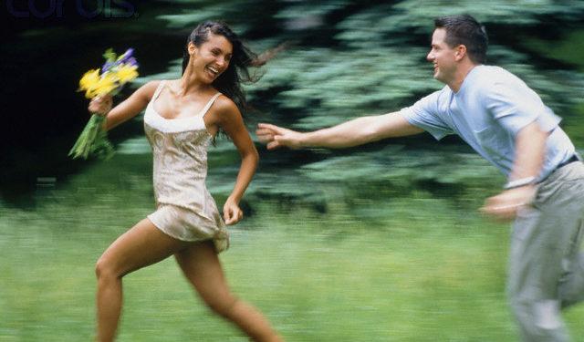 Young man following woman